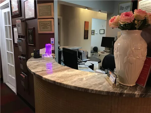 reception desk in the front office with vase of flowers