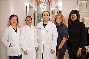 group photo of the Tribeca Dentist dental team